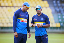 July 6, 2018 - Sri Lanka - Sri Lanka Left arm bowler Rangana Herath(R) and Batting Coach Thilan Samaraweera (L) speak at a practice session at the R.Premadasa Stadium in Colombo on July 6, 2018. Sri lanka and South Africa will play two Tests, five 50-over One-Day Internationals (ODIs), and one T20 in Sri Lanka between July 12 and August 14. The first Test between South African and Sri Lanka will be played on July 12 at the Galle International Cricket Stadium in Galle. (Credit Image: © Lahiru Harshana/Pacific Press via ZUMA Wire)