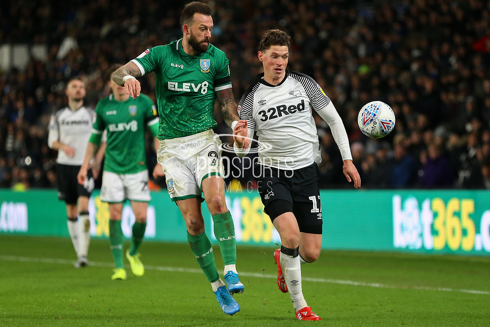 Derby County midfielder George Evans (17) & Sheffield Wednesday forward Steven Fletcher (9) chase the ball during the EFL Sky Bet Championship match between Derby County and Sheffield Wednesday at the Pride Park, Derby, England on 11 December 2019.