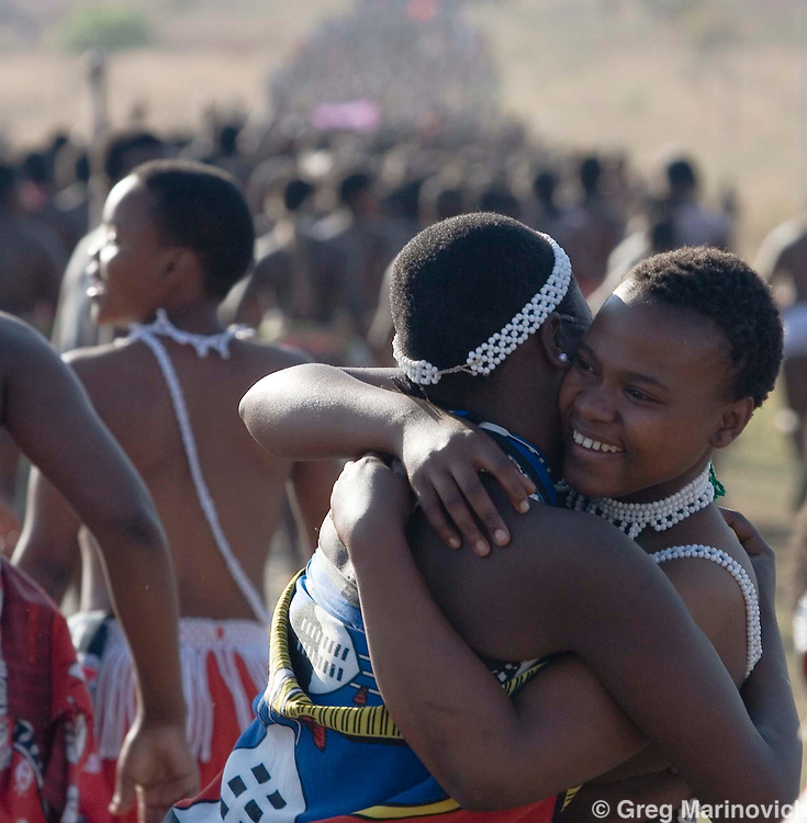 Two girls hug as thousands make their way up to the Zulu royal palace in Nongoma, KwaZulu Natal, South Africa Sept 8, 2007. Thousands of virgin girls attend the annual Reed Dance at the Enyokeni palace from which the Zulu King Zwelethini may choose a bride. Photo Greg Marinovich / Bloomberg News
