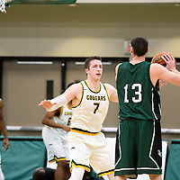 5th year forward Travis Sylvestre (7) of the Regina Cougars in action during the home game on December  2 at Centre for Kinesiology, Health and Sport. Credit: Arthur Ward/Arthur Images