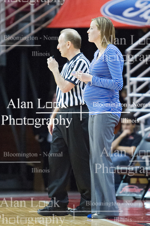 03 January 2014:  Referee Bob Trammel stands close to Jennie Baranczyk during an NCAA women's basketball game between the Drake Bulldogs and the Illinois Sate Redbirds at Redbird Arena in Normal IL