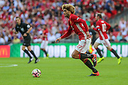 Marouane Fellaini Midfielder of Manchester United runs with the ball during the FA Community Shield match between Leicester City and Manchester United at Wembley Stadium, London, England on 7 August 2016. Photo by Shane Healey.