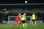Liam Boyce of Burton Albion (27) and Joe Walsh of Milton Keynes Dons (4)  during the The FA Cup third round replay match between Burton Albion and Milton Keynes Dons at the Pirelli Stadium, Burton upon Trent, England on 14 January 2020.
