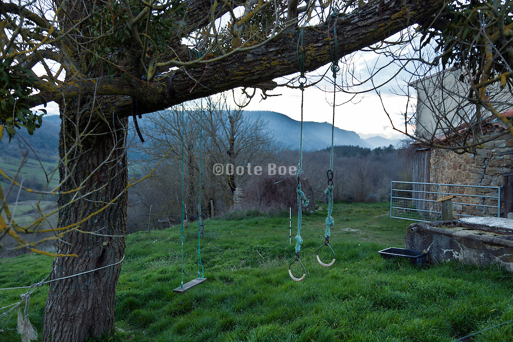 children swing in rural farming setting