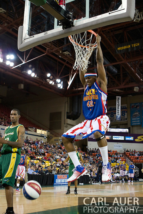 April 30th, 2010 - Anchorage, Alaska:  Harlem Globetrotter Titan (42) ends the 1st half with a thundering two handed dunk.