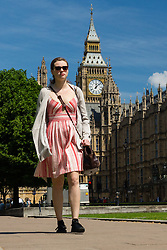 © Licensed to London News Pictures. 19/05/2014. London, UK. A woman walks in the sunshine past Big Ben, Westminster, London on 19th May 2014. Photo credit : Vickie Flores/LNP