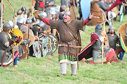 © Licensed to London News Pictures. 13/10/2018<br /> BATTLE, UK.<br /> Saxon warrior at the battle.<br /> English Heritage Battle of Hastings re-enactment at Battle Abbey,Battle, on the 1066 battle field.<br /> Photo credit: Grant Falvey/LNP