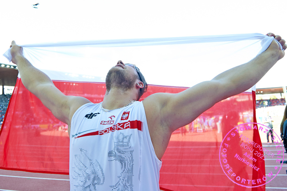 Pawel Fajdek from Poland celebrates his silver medal in men's hammer throw while medal ceremony during the Fifth Day of the European Athletics Championships Zurich 2014 at Letzigrund Stadium in Zurich, Switzerland.<br /> <br /> Switzerland, Zurich, August 16, 2014<br /> <br /> Picture also available in RAW (NEF) or TIFF format on special request.<br /> <br /> For editorial use only. Any commercial or promotional use requires permission.<br /> <br /> Photo by &copy; Adam Nurkiewicz / Mediasport