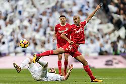 (L-R) Karim Benzema of Real Madrid, Guido Hernan Pizarro of Sevilla FC during the La Liga Santander match between Real Madrid CF and Sevilla FC on December 09, 2017 at the Santiago Bernabeu stadium in Madrid, Spain.