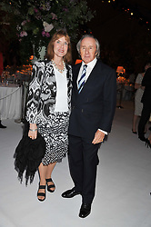 SIR JACKIE & LADY STEWART at a dinner hosted by Cartier following the following the opening of the Chelsea Flower Show 2012 held at Battersea Power Station, London on 21st May 2012.