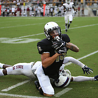 ORLANDO, FL - SEPTEMBER 08:  Tre Nixon #16 of the UCF Knights makes a reception in front of Alex Brown #30 of the South Carolina State Bulldogs during a football game at Spectrum Stadium on September 8, 2018 in Orlando, Florida. (Photo by Alex Menendez/Getty Images) *** Local Caption *** Tre Nixon; Alex Brown