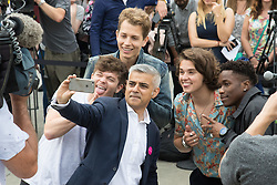 Trafalgar Square, London, July 22nd 2016. International Busking Day is launched in London by Mayor Sadiq Khan together with Jessie Ware, Tinchy Strider, Irish band Keywest and The Vamps. PICTURED: Mayor of London Sadiq Khan poses for a selfie with The Vamps and Tinchy Strider.<br /> <br /> &copy;Paul Davey<br /> FOR LICENCING CONTACT: Paul Davey +44 (0) 7966 016 296 or 020 8969 6875 paul@pauldaveycreative.co.uk