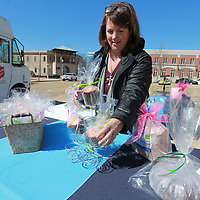 Rosemary Dillard helps set up theie bake sale goods from Renasant Bank as part of the Empty Bowls Luncheon fundraiser Wednesday at Fairpark.