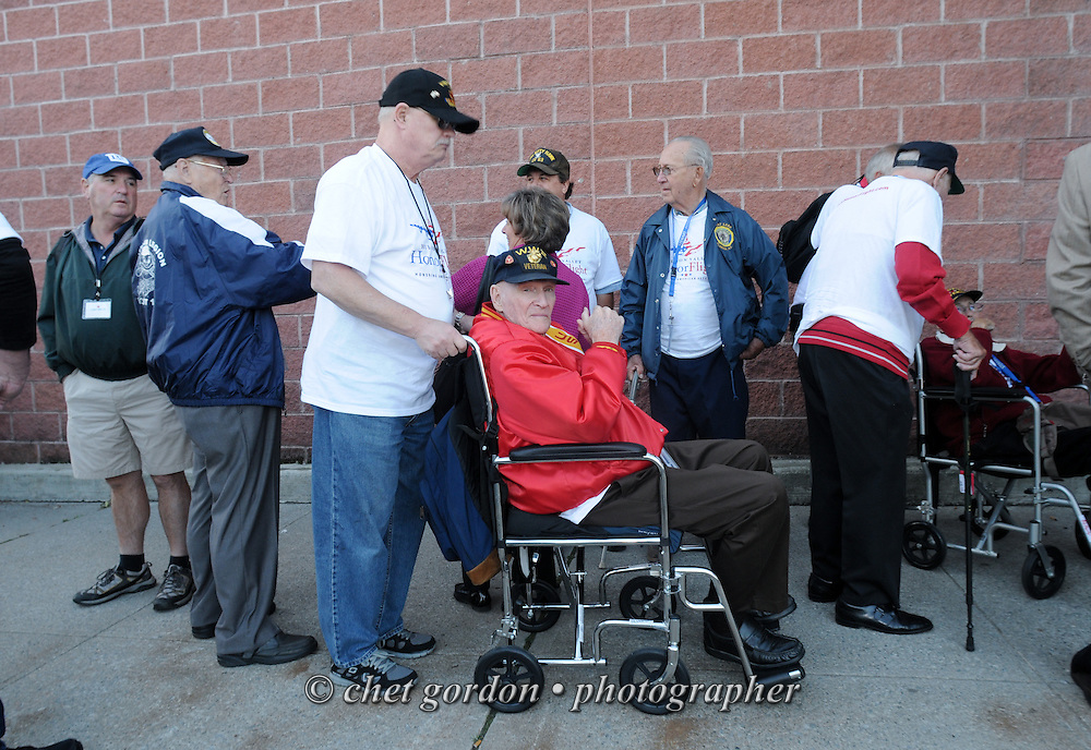MONTGOMERY, NY.  WWII Veterans and their escorts aboard the Hudson Valley Honor Flight leave the Shop-Rite Plaza in Montgomery, NY bound for Stewart International Airport and onward to the World War II Memorial in Washington, DC on Saturday, September 21, 2013.  © www.chetgordon.com