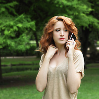 Serious young woman talking on the phone