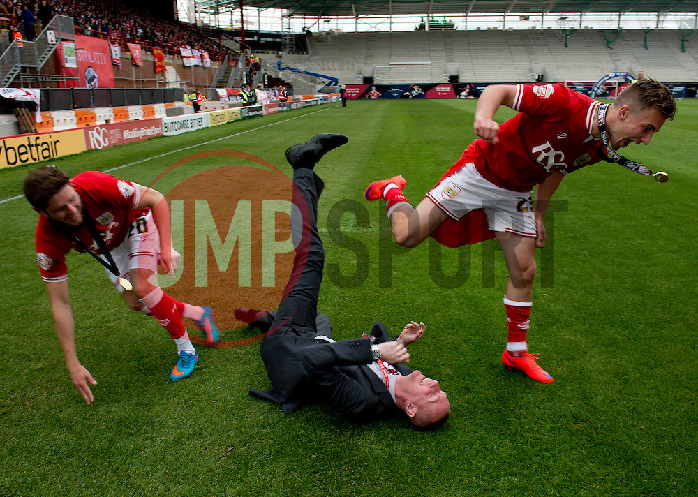 Bristol City's Joe Bryan and Bristol City's Wes Burns push Adam Baker over - Photo mandatory by-line: Dougie Allward/JMP - Mobile: 07966 386802 - 03/05/2015 - SPORT - Football - Bristol - Ashton Gate - Bristol City v Walsall - Sky Bet League One