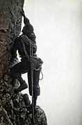 rock climber scaling a rock wall 1933 France Alps