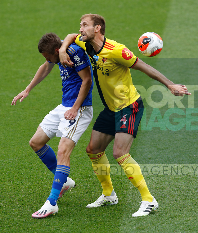 Jamie Vardy of Leicester City challenged by Craig Dawson of Watford during the Premier League match at Vicarage Road, Watford. Picture date: 20th June 2020. Picture credit should read: Darren Staples/Sportimage