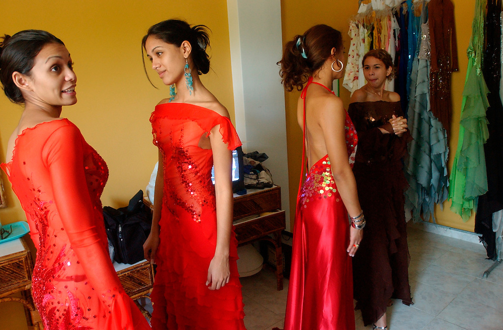 Women try on dresses before a fashion show at the Aguasal beach club.  The beach club hosts several fashion shows each year and holds its own beauty pageant.  Fashion and looking good are top priorities in Venezuela, where there is a general culture of beauty.  It is a culture that permeates all walks of life and covers the country like a blanket. Girls enter beauty pageants as toddlers and young women and men get plastic surgery as teens.  Venezuela is a country where thongs and short skirts are the norm, cleavage awaits around every corner and metrosexual men abound.