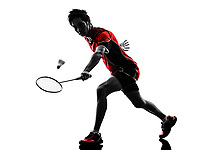 one asian badminton player young man in silhouette isolated white background
