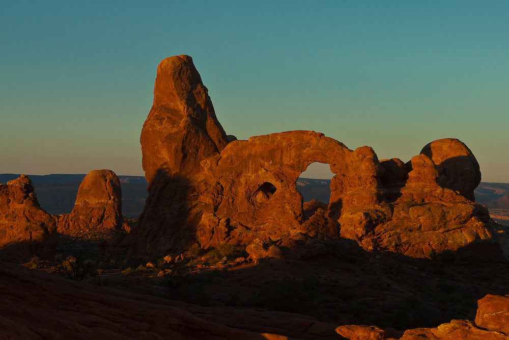 Sunrise looking through Window Arch at Turret Arch, Arches National Park, Moab, Utah, USA