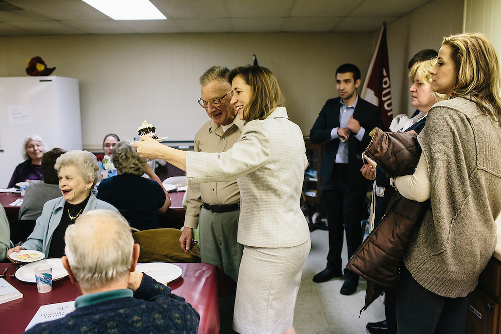 West Virginia Secretary of State Natalie Tennant jokes with Hobert Simmons about his slice of cake at the Romney First United Methodist Church in Romney, W.V. on Wednesday, April 16, 2014. Tennant is running for the US Senate seat in West Virginia against popular Republican Rep. Shelley Moore Capito.