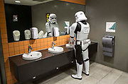 UNITED KINGDOM, London: 25 May 2019 <br /> A Star Wars Stormtrooper washes his hands at the London ExCeL during the MCM London Comic Con earlier today. Thousands of cosplay enthusiasts will come to the ExCeL Centre this weekend to enjoy the convention.