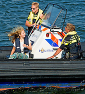 23-8-2015 AMSTERDAM - princess Amalia hangs on a policeboat  princess Amalia , princess Ariane , princess Alexia and Countess Luana and Zaria  on a policeboat during sail 2015 COPYRIGHT ROBIN UTRECHT