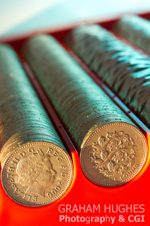 British pound coins and other denominations in post office coin hopper.