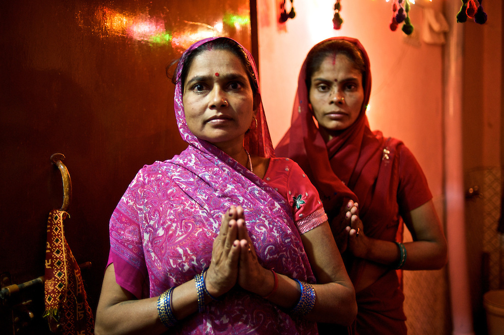 "Women from the Delhi neighborhood of Madanpur Khadar extend a traditional greeting of ""Namaskar."""
