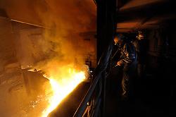 Arcelor-Mittal employees, monitor blast furnace B, at the Ougree facility near Liege, Belgium, Monday, Feb. 9, 2009. (Photo © Jock Fistick)