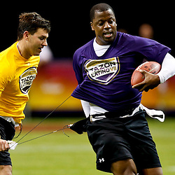 Jan 31, 2013; New Orleans, LA, USA; AFC squad Jake Delhomme grabs the flag and microphone of NFC Kordell Stewart during the Tazon Latino VII flag football game at Clinic Field  inside the Ernest Morial Convention center. Super Bowl XLVII will take place between the San Francisco 49ers and the Baltimore Ravens on February 3, 2013 at the Mercedes-Benz Superdome.  Mandatory Credit: Derick E. Hingle-USA TODAY Sports
