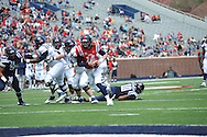 Bo Wallace (14) runs during Mississippi's Grove Bowl controlled scrimmage at Vaught-Hemingway Stadium in Oxford, Miss. on Saturday, April 5, 2014.