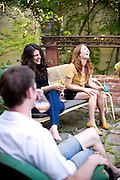 Chapel Hill/Carrboro's welcoming and laid-back community can be seen here as Tricia Mesgian, owner of Carrboro's bar Orange County Social Club,  hosts her Chapel Hill friends at her newly renovated home. (L to R Tricia Mesgian, Rebecca Mormino)