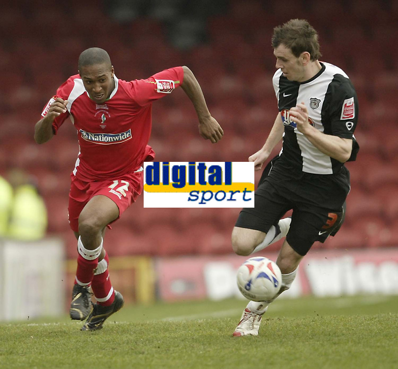 Photo: Aidan Ellis.<br /> Grimsby Town v Swindon Town. Coca Cola League 2. 17/03/2007.<br /> Swindon's Ricky Shakes (L) and Grimsby's Tom Newey chase the ball
