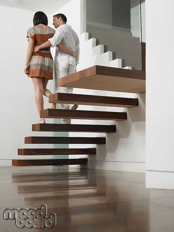 Young Couple Descending Stairs