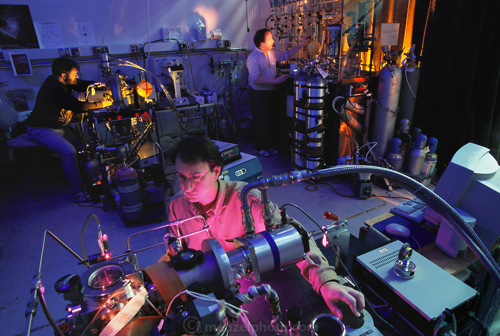 Physics: NASA/AMES Researchers in Mountain View, California. D. Hudgins, J Dworkin, M. Berstein (Left to Right). Looking for P.A.H. in the lab at Nasa Ames. Polycyclic Aromatic Hydrocarbons (PAHs) are a class of very stable organic molecules made up of only carbon and hydrogen. Photographed at NASA's Ames Research Center, California, USA.- Origin of Life 1999.