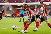Callum Robinson of Sheffield United crosses the ball during the Premier League match between Sheffield United and Crystal Palace at Bramall Lane, Sheffield, England on 18 August 2019.