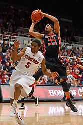 Feb 16, 2012; Stanford CA, USA; Oregon State Beavers forward Devon Collier (44) shoots past Stanford Cardinal guard Chasson Randle (5) during the second half at Maples Pavilion.  Mandatory Credit: Jason O. Watson-US PRESSWIRE