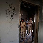 Libyan rebel fighters praying inside an outpost near Bir Ayyad, in the western mountains of Libya.