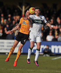 CAMBRIDGE JAMES DUNNE BATTLES WITH PLYMOUTHS GRAHAM CAREY, Cambridge United v Plymouth Argyle, Sky Bet League Two Abbey Stadium, Saturday 4th February 2017. <br /> Score 0-1 (SARCEVIC)