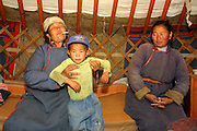 TERELJ, MONGOLIA..09/04/2001.In a ger. Mukthir (l., w. cigarette).(Photo by Heimo Aga)