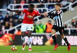 Paul Pogba of Manchester United holds off Dwight Gayle of Newcastle United - Mandatory by-line: Matt McNulty/JMP - 11/02/2018 - FOOTBALL - St James Park - Newcastle upon Tyne, England - Newcastle United v Manchester United - Premier League
