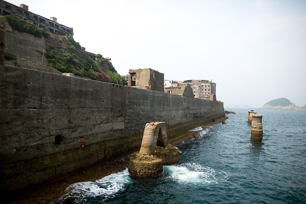 """NAGASAKI, JAPAN - AUGUST 8: Hashima Island, commonly known as Gunkanjima or """"Battleship Island"""" in Nagasaki Prefecture, southern Japan on August 8, 2017. The island was a coal mining facility until its closure in 1974 is a symbol of the rapid industrialization of Japan, a reminder of its dark history as a site of forced labor during the Second World War. The island now is recognized as UNESCO's World Heritage sites of Japan's Meiji Industrial Revolution. (Photo: Richard Atrero de Guzman/AFLO)"""