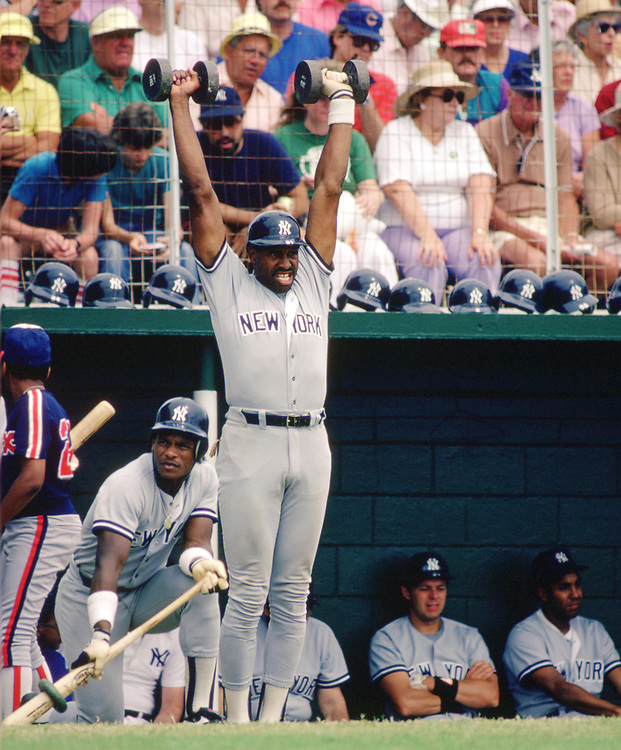 SARASOTA, FL - 1986:  Dave Winfield of the New York Yankees lifts weights during a major league baseball spring training game at Payne Park in Sarasota, Florida prior to the 1986 season.  (Photo by Ron Vesely) Subject:   Dave Winfield