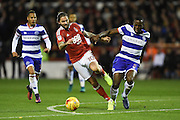 Nottingham Forest midfielder Henri Lansbury (10) battles for possession with Queens park Rangers defender Nedum Onuoha (5) during the EFL Sky Bet Championship match between Nottingham Forest and Queens Park Rangers at the City Ground, Nottingham, England on 5 November 2016. Photo by Jon Hobley.