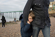 A 9 year-old boy plays with his dad on the beach at Clevedon Pier, on 27th December 2018, in Clevedon, North Somerset, UK.