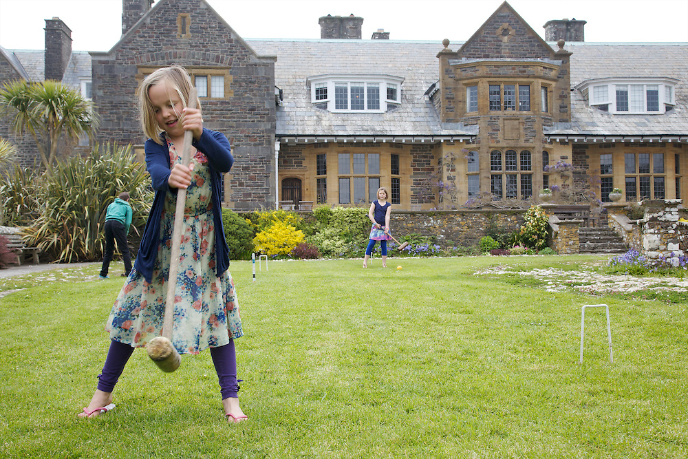 Playing croquet in the garden at Pickwell Manor. From left to right: Zac Baker (11), Milly-grace (8), Liza Baker (9). Pickwell Manor, Georgeham, North Devon, UK.<br /> CREDIT: Vanessa Berberian for The Wall Street Journal<br /> HOUSESHARE