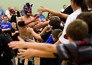 """Young fans congratulate crowd-favorite Lince Dorado (Jose Cordero) after he wins a close match against Chasyn Rance during Championship Wrestling Entertainment's """"Wrestlefest"""" at the Port St. Lucie Civic Center on Friday, April 10, 2015. (XAVIER MASCAREÑAS/TREASURE COAST NEWSPAPERS)"""