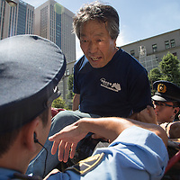 August 21,2016 Tokyo , after police  evacuate  antinuclear  tent at  3 o clock  of the  morning built  since  Fukushima nuclear catastrophy, front of the minister of economy technologies and Industry,Farmer  from fromNamie who live in forbidden zone  with contamined cows came to support antinuclear occupy activists  . Pierre Boutier